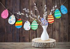 Easter painted paper eggs with branches  willow. On wooden background royalty free stock image