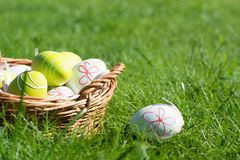 Easter painted pastel color eggs with ribbon on green grass. Sunny day. Close up. Selective focus. royalty free stock images