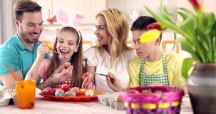 Easter painting – family coloring eggs stock footage