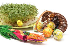 Easter palm and eggs in overturned wicker basket Stock Photos