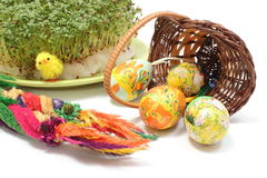Easter palm and eggs in overturned wicker basket and watercress Stock Photos