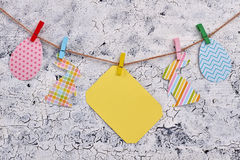 Easter paper cutouts and clothespins. Royalty Free Stock Photos