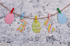 Easter paper cutouts on rope. royalty free stock photo