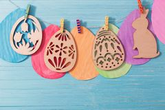 Easter paper eggs on wooden background Stock Photo