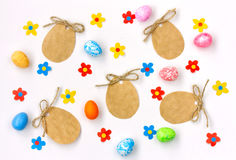 Easter paper tag with a rope, applique multicolored flowers, egg Stock Images