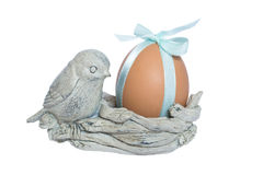 About bird nest. Easter paraphernalia.About bird nest. Egg as a gift. White background Royalty Free Stock Image