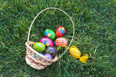 Easter Holiday. Easter paraphernalia. Colored eggs scattered in the grass Stock Image