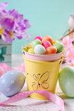 Easter pastel colors decoration with candy eggs in small bucket Royalty Free Stock Images