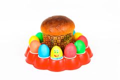 Easter pastries and colored Easter eggs on white background Stock Photography