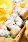 Easter pastry, Easter lambs with icing sugar in basket, daffodils Royalty Free Stock Photo