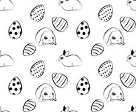Easter pattern with eggs and rabbits. Black and white vector illustration. Vector seamless easter pattern with eggs and cute rabbits, black and white Royalty Free Stock Photo