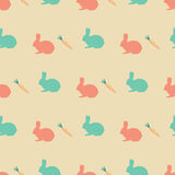 Easter pattern with rabbits and eggs for textures, wrapping, covers. Easter pattern with nice rabbits and carrots for textures, wrapping, covers Stock Photo