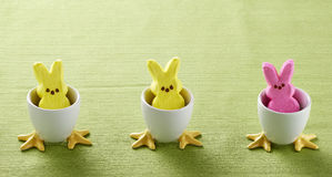 Easter Peeps. In cups on green table stock image