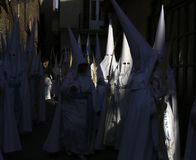 Easter 013. Penitents wearing white hoods seen during easter celebrations in the island of Majorca, Spain Royalty Free Stock Photo