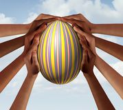 Easter People Seasonal Spring Group. Easter people coming together as a group of diverse community members holding a decorated spring holiday egg in a Royalty Free Stock Photography