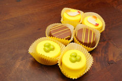 Easter petit fours. On a wooden table Stock Photography