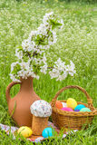 Easter picnic on the green lawn in the garden Royalty Free Stock Images