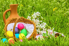 Easter picnic on the spring flowered meadow Stock Photos