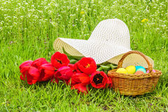 Easter picnic on the spring green meadow Stock Images
