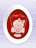 Easter Pink bird in swing. On easter egg and decorated background Stock Photography