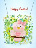 Easter Pink bird in swing. On spring decorated background and greeting Happy Easter Royalty Free Stock Images
