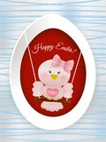 Easter Pink bird in swing. On easter egg and decorated background Stock Image