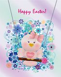 Easter Pink bird in swing. On spring decorated background and greeting Happy Easter Stock Image