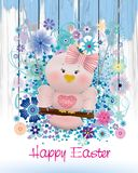 Easter Pink bird in swing and spring flowers. Easter card with Easter Pink bird on spring flowers background and greeting Happy Easter Stock Images