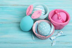 Easter pink and blue eggs with bunny ears Royalty Free Stock Photos