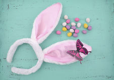 Easter pink bunny ears on aqua blue wood Royalty Free Stock Photography