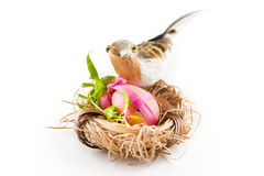 Easter pink egg in nest with bird Royalty Free Stock Images
