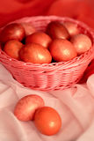 Easter pink eggs in basket. Easter pink colorful eggs in basket Stock Images