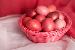 Easter pink eggs in basket. Easter pink colorful eggs in basket Royalty Free Stock Photos