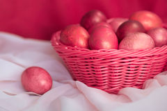 Easter pink eggs in basket. Easter pink colorful eggs in basket Stock Image