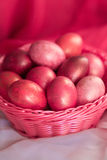Easter pink eggs in basket. Easter pink colorful eggs in basket Royalty Free Stock Image