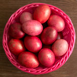 Easter pink eggs in basket Royalty Free Stock Image