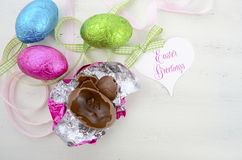 Easter pink, green, and blue foil wrapped chocolate eggs Royalty Free Stock Photo