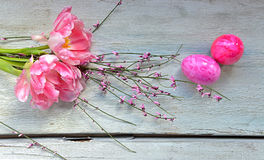 Easter Pink tulips on wood background Royalty Free Stock Images