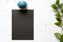 Easter place setting menu with broken egg, dyed blue Royalty Free Stock Photography