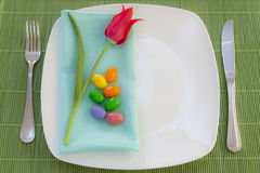 Easter place setting with spring flowers Stock Photo