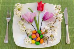 Easter place setting with spring flowers Royalty Free Stock Photo
