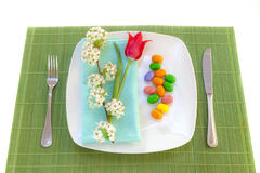 Easter place setting with spring flowers Stock Image