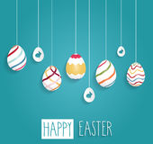Easter poster. Hanging eggs on blue background with handwritten text Stock Photo