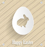 Easter poster. Wooden background with paper easter egg Royalty Free Stock Photography