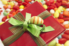 Easter present with ribbon and easter eggs, sugar eggs Royalty Free Stock Photos