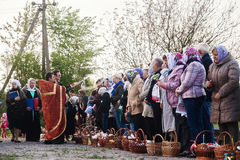 At Easter, the priest blesses the people with baskets and candles. Ukraina.Fastov. May 1, 2016 Royalty Free Stock Photography