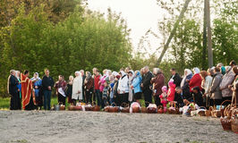 At Easter, the priest blesses the people with baskets and candles. Ukraina.Fastov. May 1, 2016 Royalty Free Stock Image