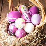 Easter purple eggs in basket Stock Images