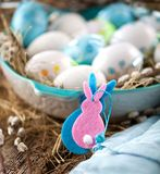 Easter Pussy-willow and blue Easter egg on wooden background. Ha. Ppy Easter card Text in German Happy Easter royalty free stock photos