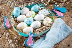 Easter Pussy-willow and blue Easter egg on wooden background. Ha. Ppy Easter card Text in German Happy Easter royalty free stock images
